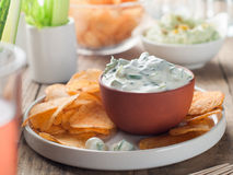 Potato chips with dip Stock Photography
