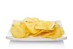 Potato chips on a dish stock photo