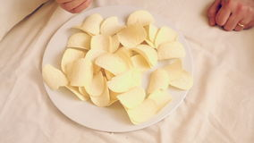Potato chips on a dish stock video footage