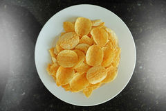 Potato chips in the dish Royalty Free Stock Images
