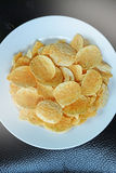 Potato chips in the dish Stock Photography