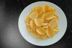 Potato chips in the dish Stock Photo