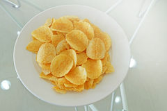 Potato chips in the dish Stock Photos