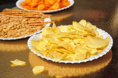 Potato chips, dry seeds and cookies Royalty Free Stock Photos