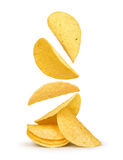Potato chips falling in the air. On an isolated white background Stock Photography
