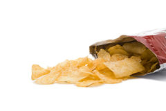 Potato chips falling from bag Stock Photo