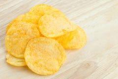 Potato chips. Fresh potato chips on table royalty free stock photo