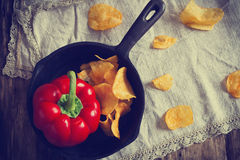 Potato chips in a frying pan Royalty Free Stock Image