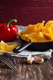 Potato chips in a frying pan Stock Images