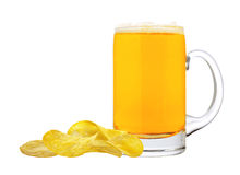 Potato chips and glass of beer isolated on white Royalty Free Stock Images