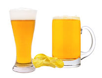 Potato chips and glass of beer isolated on white Stock Photos