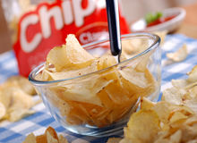 Potato chips. In the glass bowl stock photo