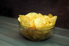 Potato chips. In a glass bowl Royalty Free Stock Photo