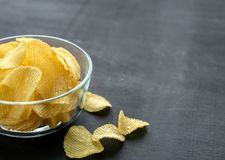 Potato chips in the glass bowl Stock Photos