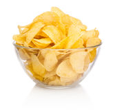 Potato chips in glass bowl isolated on white background Royalty Free Stock Photos