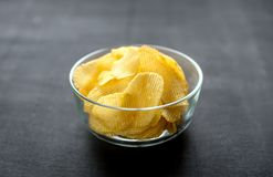 Potato chips in the glass bowl Royalty Free Stock Image