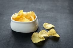 Potato chips in the glass bowl Stock Photography