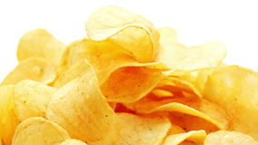 Potato chips heap rotating over white stock video footage