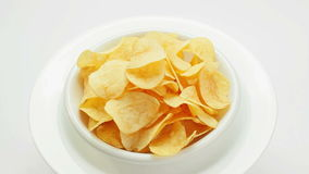 Potato chips heap rotating on a white plate stock video