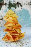 Natural potato chips with sea salt on a light background. Diet. royalty free stock photo