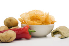 Potato chips and ingredients Stock Photos