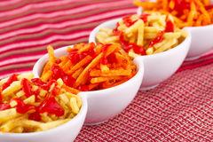 Potato chips with ketchup Stock Photo