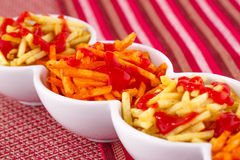Potato chips with ketchup Royalty Free Stock Images