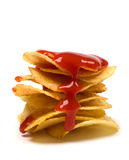 Potato chips with ketchup isolated on white Royalty Free Stock Photos