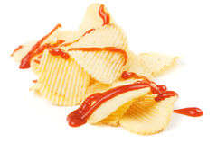 Potato chips with ketchup isolated on white Royalty Free Stock Photography