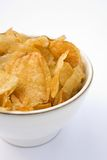 Potato Chips Kettle Type. Crispy Kettle type potato chips in a country bowl Stock Image