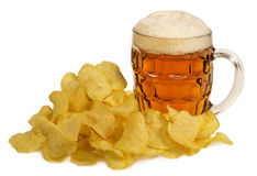 Potato chips and mug of beer isolated on white background Royalty Free Stock Images