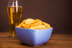 Potato chips and mug of beer Royalty Free Stock Photo
