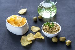 Potato chips with olive tapenade Royalty Free Stock Image