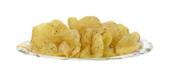 Potato chips on paper plate Stock Image