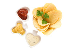 Potato chips with parsley and sauces Stock Photo