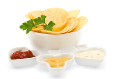 Potato chips with parsley and sauces Royalty Free Stock Images