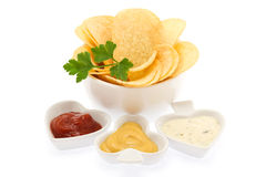 Potato chips with parsley and sauces Stock Photos