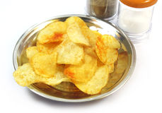 Potato Chips with pepper and salt Stock Photography