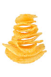 Potato chips. Pile of potato chips in isolated white background Royalty Free Stock Photos