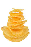 Potato chips. Pile of potato chips in isolated white background Royalty Free Stock Photography