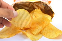 Potato chips. Pile of potato chips in isolated white background Royalty Free Stock Images
