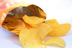 Potato chips. Pile of potato chips in isolated white background Royalty Free Stock Image