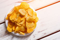 Potato chips pile on plate. Stock Images