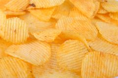 Potato chips. Pile of potato chips in  white background Royalty Free Stock Image