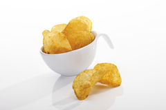 Potato chips in plastic cup Royalty Free Stock Photo