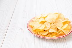 potato chips on plate Royalty Free Stock Images
