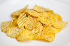 Potato chips on a plate Royalty Free Stock Photos