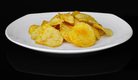 Potato chips on a plate Stock Images