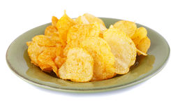 Potato chips on plate Royalty Free Stock Image