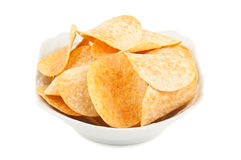 Potato chips on the plate Stock Photography